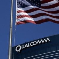 File photo of U.S. flag flying next to one of Qualcomm's many buildings in San Diego, California