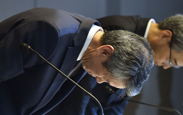 President of Toshiba, Hisao Tanaka (L) bows at the end of a press conference at the company's headquarters in Tokyo on July 21, 2015. Toshiba president Hisao Tanaka and his predecessor Norio Sasaki quit the company on July 21 as one of Japan's best-known firms was hammered by a 1.2 billion USD accounting scandal blamed on management's overzealous pursuit of profit. AFP PHOTO / KAZUHIRO NOGI (Photo credit should read KAZUHIRO NOGI/AFP/Getty Images)